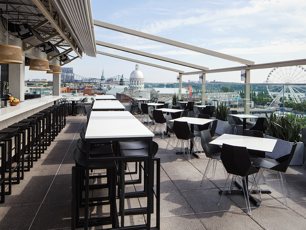 A photo of the Terasse William Gray with tables, chairs and views of Old Montreal